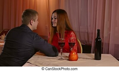 man and girl romantic evening in restaurant kiss drinking...