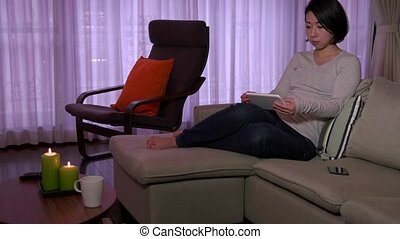 Woman Girl Relaxing iPad Tablet - Young Japanese woman...