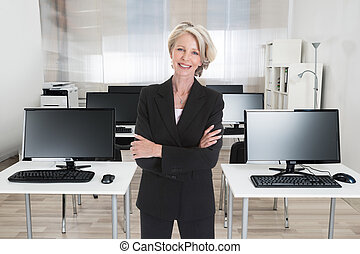 Portrait Of Excited Businesswoman Raising Hand On White...