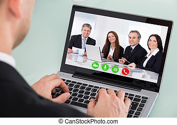 Businessman Looking At Video Conference On Laptop - Close-up...
