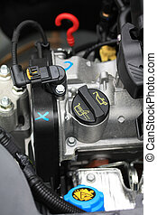view under the hood - small car engine - Details of a small...