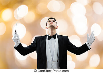 Music Conductor Looking Up While Holding Baton