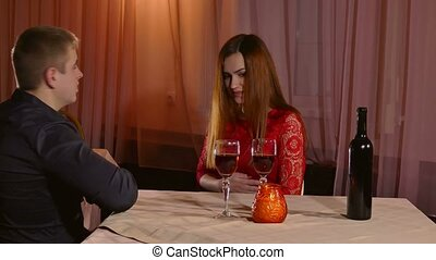 Woman sick on a date at the restaurant bad stomach ache -...