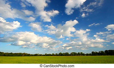 Midwest Prairie Scenery - Beautiful clouds hover over a vast...