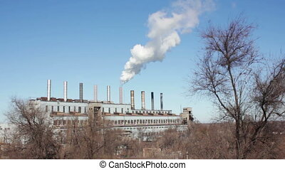Smoke from Pipes of the Industrial Plant in the City. -...