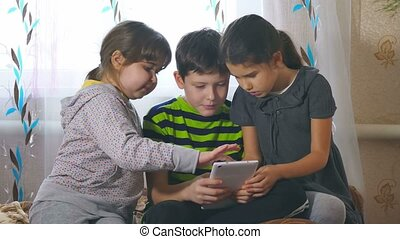 children play in tablet girls and boy - children play in...