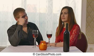 girl yawning at a restaurant for a romantic evening with...