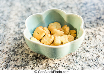 biscuits in a bowl on the granite table