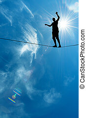Silhouette of man on the rope concept of risk taking and...