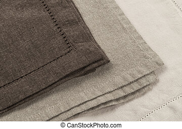 Linen napkins - Edges of linen cloth napkins in brown and...