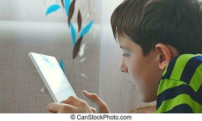 boy teenage playing on tablet game browsing - boy teenage...