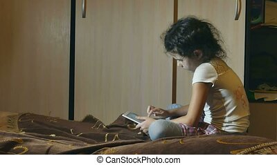 girl with browsing tablet in room watching internet online...