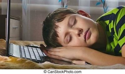 boy fell sleep on the laptop - boy  fell sleep on the laptop