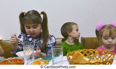 Children eat boy and girl family breakfast birthday...