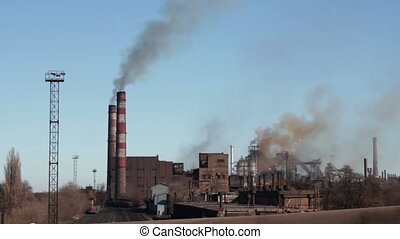 Smoke from Pipes of the Industrial Plant in the City.