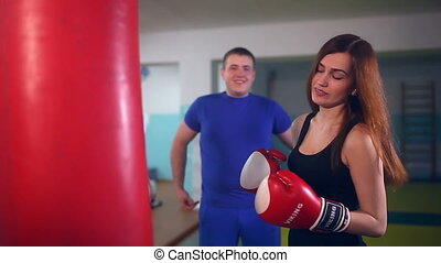 man boxer coach teaches girl boxing at gym sport - man boxer...