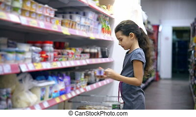 girl teen in supermarket to buy food dairy yogurt