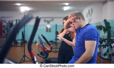 man male athlete drinking water get tired in gym trainers