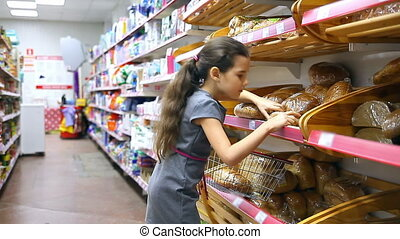 girl teen with in supermarket to buy baking food bread -...