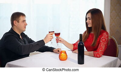 man and woman romantic evening love in restaurant drinking...