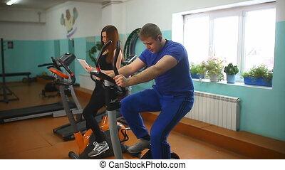 girl man gym fitness exercise bike - girl man gym fitness...