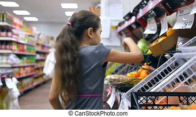 girl supermarket buy - girl teen in supermarket buy...