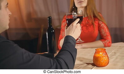 man and woman romantic evening in restaurant love candle...