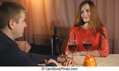 man and woman romantic evening in love candle restaurant...