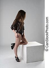 Studio shot of slim model in black lace bodysuit - Studio...