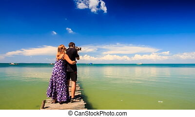 Camera Moves Blond Girl Guy Stand on Pier she Arms he Photos