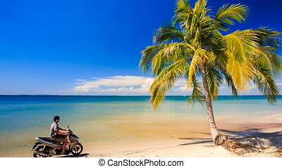 Guy on Scooter Drives to Stops at High Palm on Beach - guy...