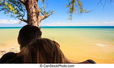 Closeup Backside Guy Girl Sit in Front of Tree Admire Sea -...