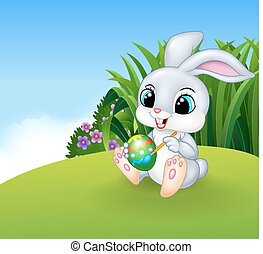 Cute Easter Bunny painting an egg - Vector illustration of...