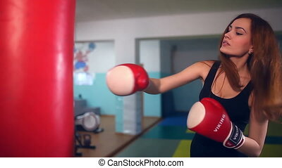 Girl boxer in boxing has been punching bag sport - Girl...