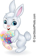 Cartoon Easter bunny holding colour - Vector illustration of...