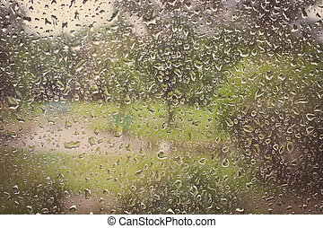 Vintage photo, Dripping down drops of rain on glass -...