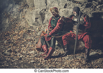 Old knight with the sword and his squire armed with bow....