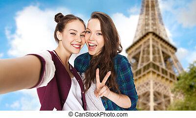 happy friends taking selfie over eiffel tower - people,...