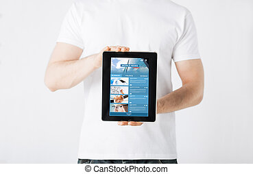 close up of man with business news on tablet pc