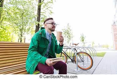 happy hipster man eating sandwich with coffee - people,...