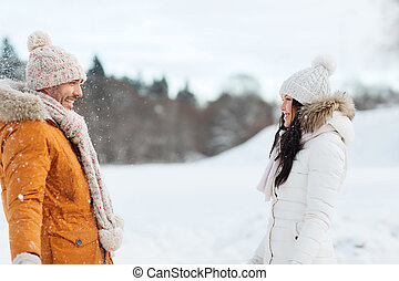 happy couple walking over winter background - people,...