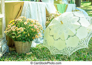 flowers in basket and Lace umbrella wedding accessory...