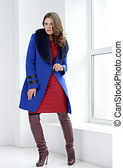 Girl in studion posing at coat - Young girl in studio posing...