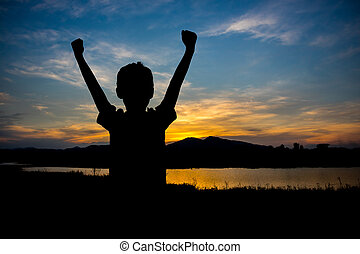 Child hands up at Sunset - Silhouette of Child hands up at...