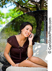 Woman Using Phone - An attractive caucasian woman talking on...