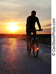 cyclist at sunset time