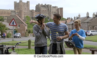 Family Bike Ride - Father and Sons stopping in a village in...