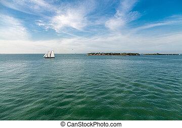 Schooner Sailing Past Island - Schooner under sails sailing...
