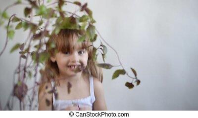 Little girl picking basil leaves