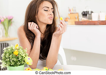 smiling female kissing a little baby easter chicken -...